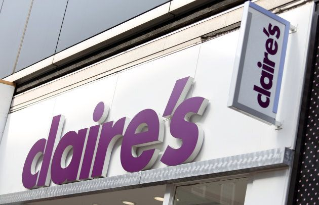 A Claire's logo sits on display above the entrance to a Claire's Accessories store in