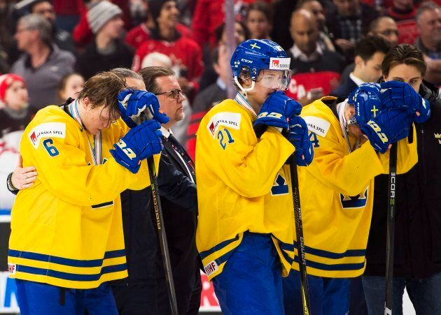 Sweden defenceman Linus Högberg (6) and Jesper Boqvist (21) look on after being defeated by Canada during...