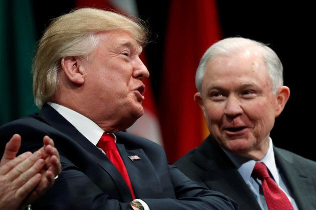 President Donald Trump sits with Attorney General Jeff Sessions during the FBI National Academy graduation...