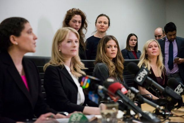 Lawyers Alexi Wood (left) and Tatha Swann (second from left) and plaintiffs Hannah Miller, Patricia Fagan,...