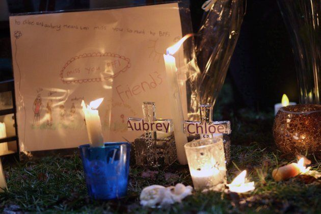 Pictures and notes from friends and classmates make up a memorial in support and memory of Aubrey Berry,...