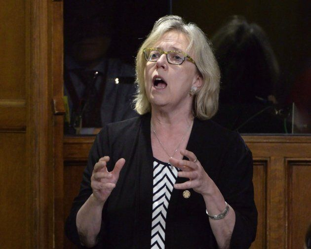Green Party Leader Elizabeth May asks a question during question period in the House of Commons on Parliament...