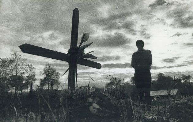 An Ojibwa person contemplates a family member's death at a cemetery at Grassy Narrows reservation near...