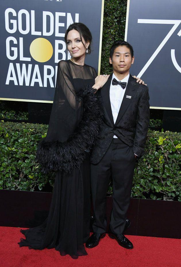 Angelina Jolie and Pax Jolie-Pitt attend the Golden Globe Awards on Jan. 7,