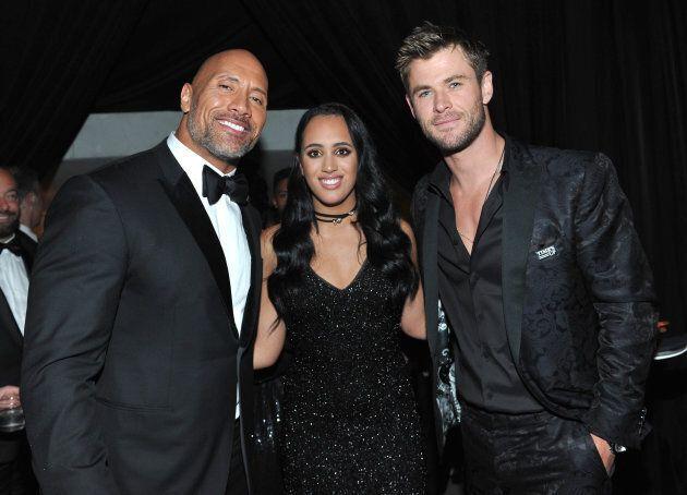 Dwayne Johnson, Golden Globe Ambassador Simone Garcia Johnson, and Chris Hemsworth at the Golden Globe...