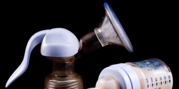 Breast pump milk on black background mother   formula baby bottle, milk