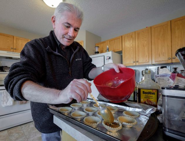 Roger Marple, who was diagnosed with early-onset Alzheimer's in 2015 at age 57, bakes butter tarts in...