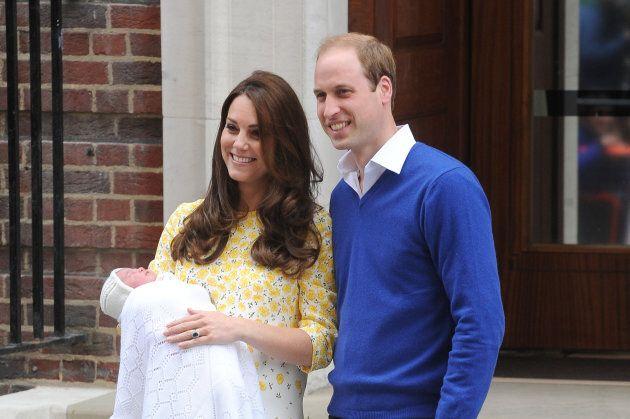 The duke and duchess show off Princess Charlotte.