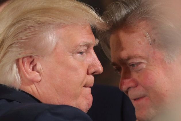 U.S. President Donald Trump talks to Steve Bannon during a swearing in ceremony for senior staff at the...
