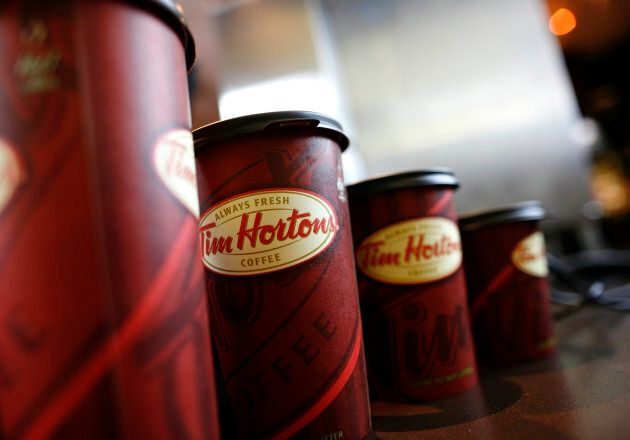 A row of Tim Hortons coffee cups are lined up for customers at Penn Station in New York on July 13,