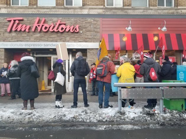 Protesters outside a Tim Hortons at the corner of Spadina and College streets in Toronto, Jan. 10,