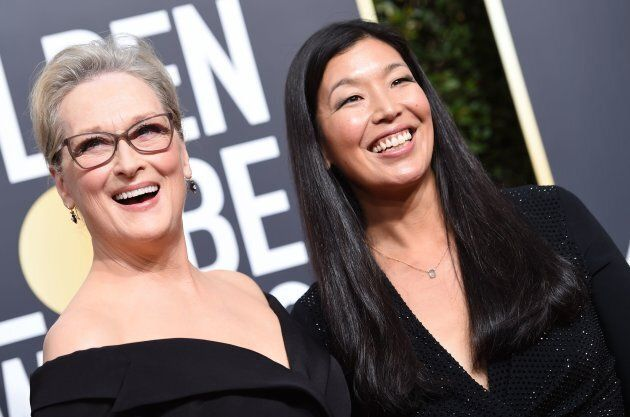 Meryl Streep and Ai-jen Poo, the head of the National Domestic Workers Alliance, at the 75th Golden Globe Awards on Jan. 7.