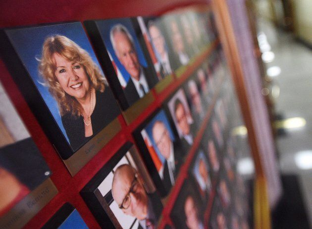 A picture of Sen. Lynn Beyak accompanies other senators official portraits on a display outside the Senate on Parliament Hill in Ottawa on Sept. 21, 2017.
