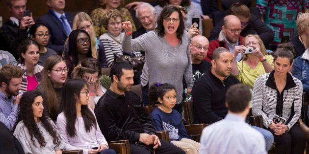 A woman heckles Prime Minister Justin Trudeau during a town hall event at Western University in London,...