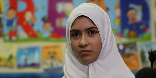 Khawlah Noman, 11, speaks to reporters at Pauline Johnson Junior Public School, after she told police...