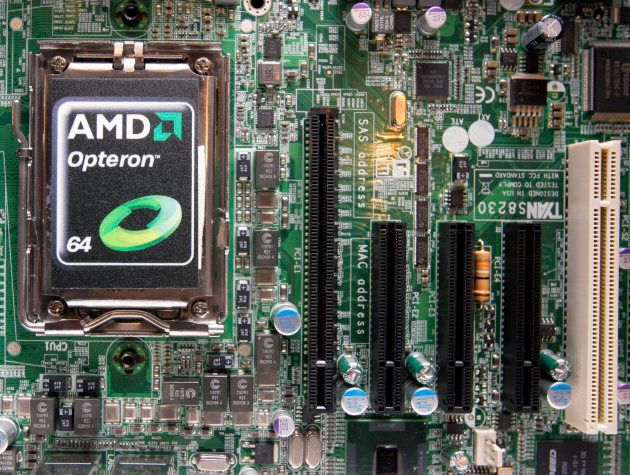 An AMD processor shown on a motherboard.