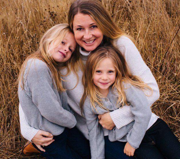 Sarah Cotton holds her daughters Chloe, left, and Aubrey Berry in October 2017 in this handout