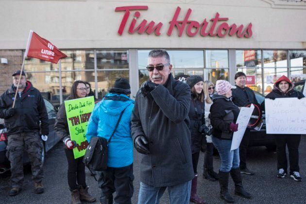 President of Ontario Federation of Labour Chris Buckley joins protesters outside a Tim Hortons Franchise...