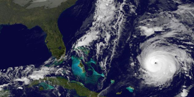 This image provided by NOAA Thursday Oct. 16, 2014 shows Hurricane Gonzalo, lower right. At 2 a.m. EDT...