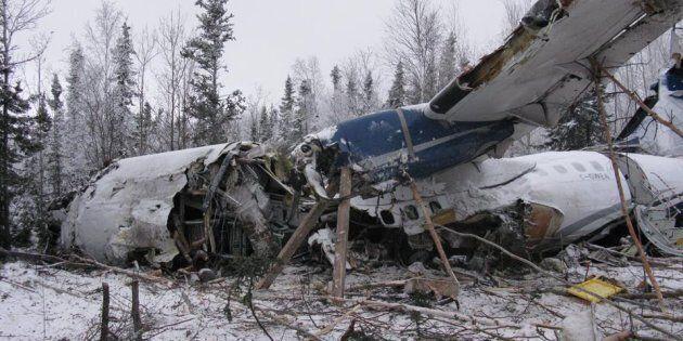 The wreckage of an aircraft is seen near Fond du Lac, Sask. on Dec. 14, 2017 in this handout