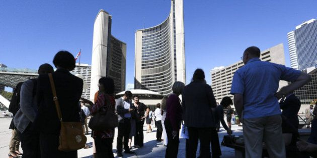 TORONTO, ON - SEPTEMBER 25: City Hall workers gather in Nathan Phillips Square after the evacuation.A...