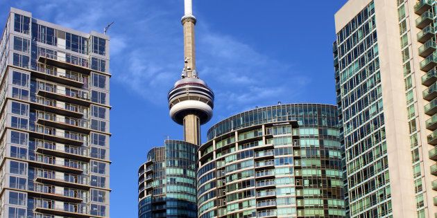 The CN Tower is seen behind condo towers on Toronto's waterfront. The city has surpassed Vancouver to be Canada's most expensive rental market.