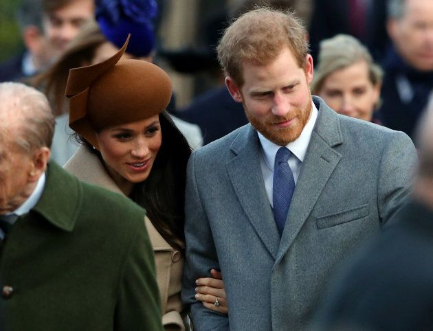 Prince Harry and his fiancee, Meghan Markle, arrive at St. Mary Magdalene's church for the Royal Family's...