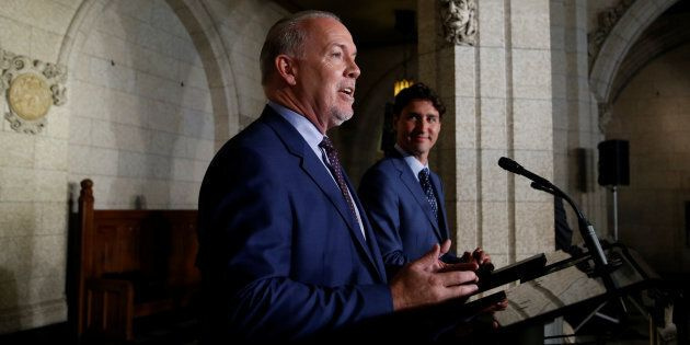 Prime Minister Justin Trudeau and B.C. Premier John Horgan take part in a news conference on Parliament...
