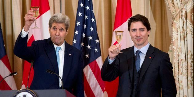 Former U.S. secretary of state John Kerry makes a toast with Prime Minister Justin Trudeau during a luncheon...