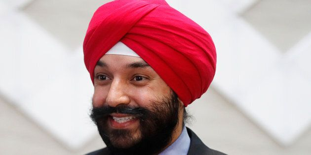 Innovation Minister Navdeep Bains smiles during an announcement in Toronto on Dec. 12,