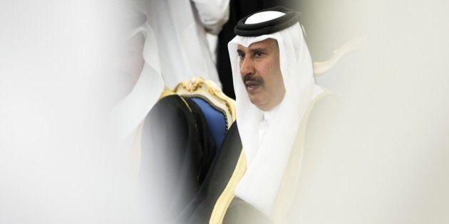 Qatari former Prime Minister Sheik Hamad bin Jassem bin Jabr al-Thani attends a ceremony with dignitaries...