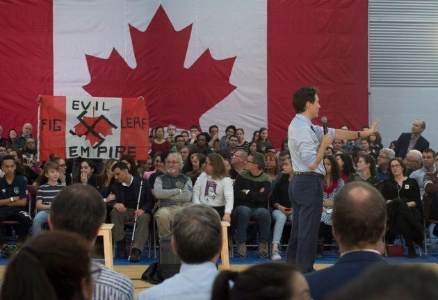 A heckler screams at Prime Minister Justin Trudeau during a town hall meeting on