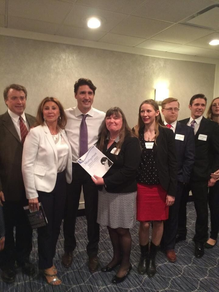 """Dr. Angela Bowen gives Prime Minister Justin Trudeau the """"Mother First"""" report on April 27, 2016 in Saskatoon."""