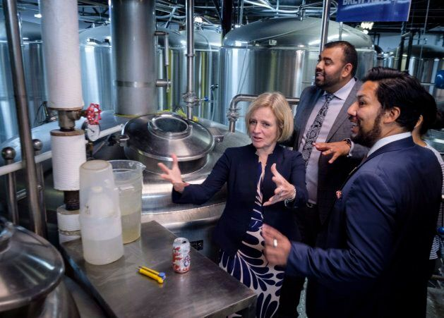 Alberta Premier Rachel Notley, right, gestures as she tours a microbrewery in Calgary, Alta., Jan. 18,