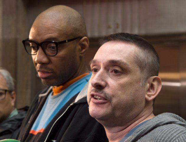 Church and Wellesley community members Alphonso King (left) and John Allan answer questions following...