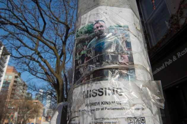 A worn missing poster for Andrew Kinsman is taped to a pole in the Church and Wellesley neighbourhood...