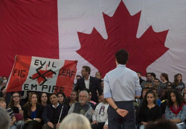 A heckler screams at Prime Minister Justin Trudeau during a town hall meeting on Jan. 18, 2018 in Quebec
