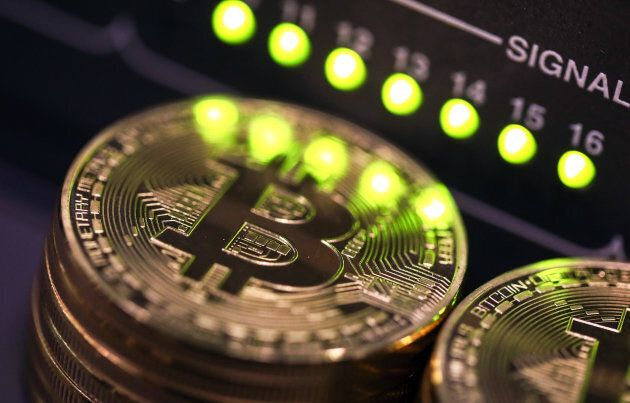 tacks of bitcoins sit near green lights on a data cable terminal inside a communications room at an office...