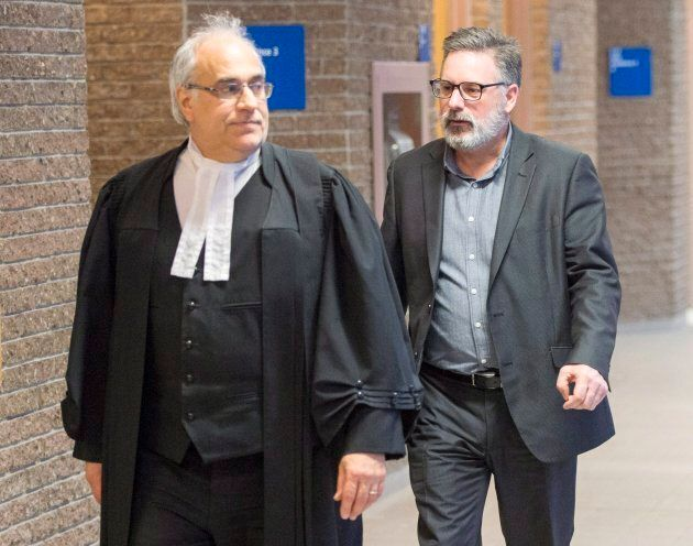Manager of train operations Jean Demaitre, right, speaks with his lawyer Gaetan Bourassa, after the jury...