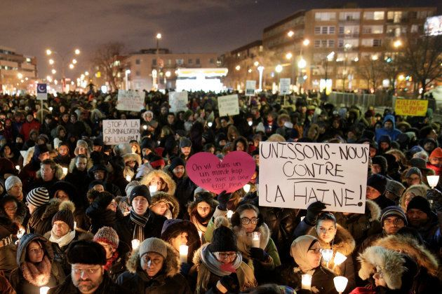 People attend a vigil in support of the Muslim community in Montreal, Quebec, on Jan. 30,
