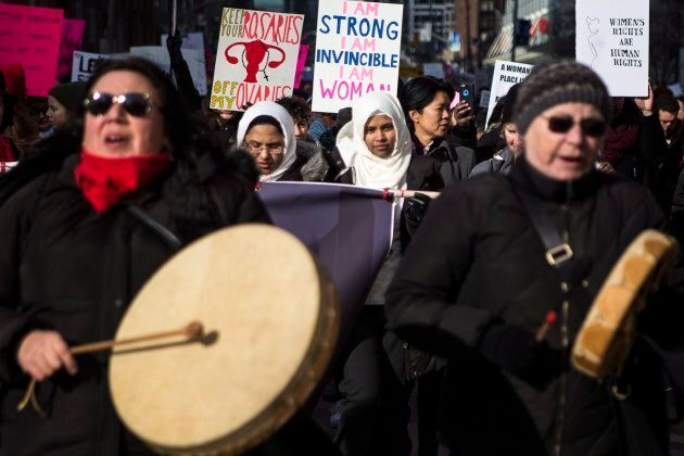 People participate in a Women's March in Toronto on