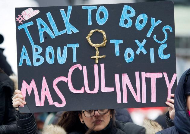 A woman holds up a sign during a women's demonstration in Montreal on