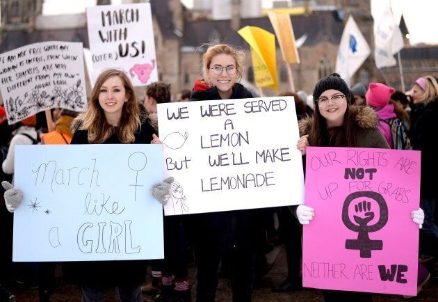 Katie Brisco, Sarah MacKenzie and Julia Manning stand for a photo during the Ottawa Women's March on...