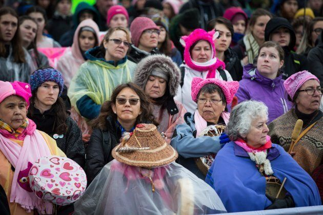 Women listen to speeches during a women's march in Vancouver on