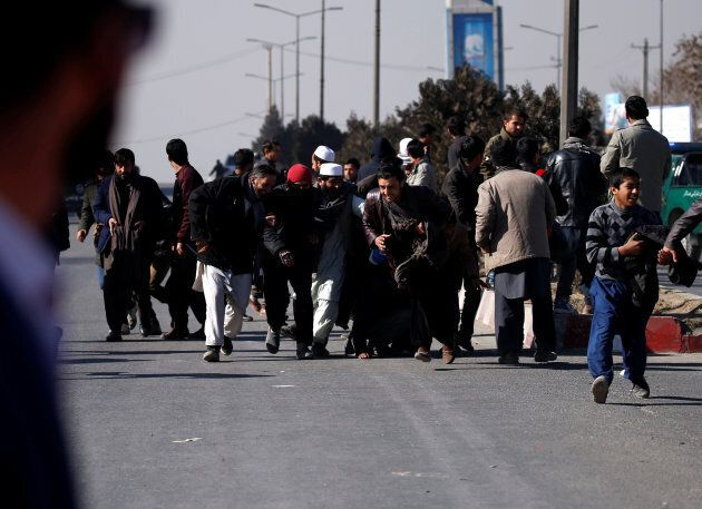 People escape during an attack on the Intercontinental Hotel in Kabul, Afghanistan on Jan. 21,