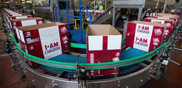 Empty cardboard cases make their way down a conveyor where they will be packaged with beer.