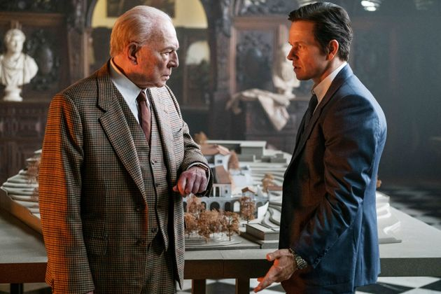 Christopher Plummer, as J. Paul Getty, and Mark Wahlberg in