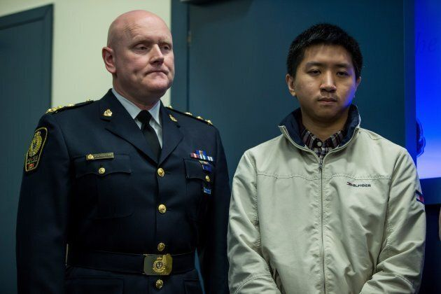 Vancouver Police Chief Adam Palmer stands with Wilfred Wong during a news conference on