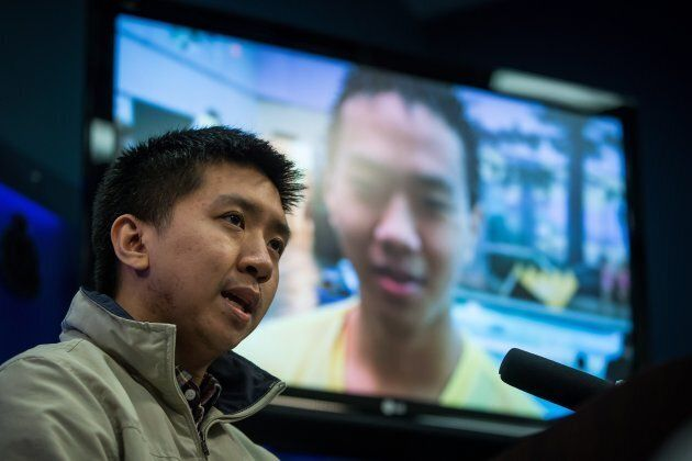 Wilfred Wong speaks about his brother Alfred Wong, 15, seen on a television, who was an innocent victim...