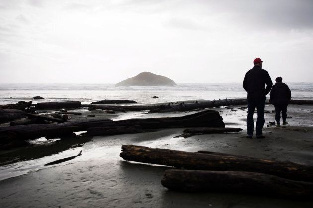 Nancy and Doug Quist walk over driftwood from the recent storms along Long Beach in the Pacific Rim National...